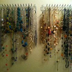 Tie racks as necklace organizers