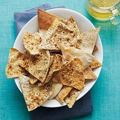 These crispy chips will complete any appetizer dip. Double or triple the recipe to serve to a large crowd or pack extras for lunchboxes. Serve them with Creamy Garbanzo Dip with Sun-Dried Tomatoes, Happy-Hour Hummus, or Black Bean Dip. Healthy Salty Snacks, Yummy Snacks, Snack Recipes, Cooking Recipes, Yummy Food, Healthy Eating, Healthy Food, Healthy Recipes, Healthy Munchies