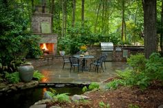 Outdoor Kitchen+ Stone Patio+ Water fixture+Outdoor fireplace+ wooded area= dream backyard