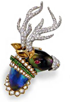 Reindeer brooch by David Webb Designed as a baroque cultured pearl antelope head, with circular-cut diamonds and emerald accents, to the cabochon ruby eye, pavé-set diamond antlers and nose, mounted in gold and platinum Signed David Webb © Christies David Webb, High Jewelry, Jewelry Art, Vintage Jewelry, Jewelry Design, Jewellery, Antique Jewelry, Christmas Jewelry, Schmuck Design