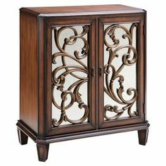 Wood cabinet with fretwork detail.    Product: Cabinet    Construction Material: Wood and mirrored glass  Color:  Brown   Features: Two doors Dimensions: 38.5 H x 38 W x 16 D