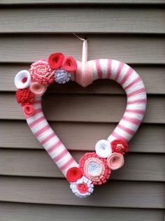 Valentine's Day Heart Wreath - Pink & White Yarn decorated w/ felt flowers. Valentine's Day Wreath- Valentine's Day Decoration -Heart Wreath by stringnthings on Etsy https://www.etsy.com/listing/120372345/valentines-day-heart-wreath-pink-white