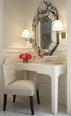 A beautiful venetian glass mirror adds elegance to a dressing table.