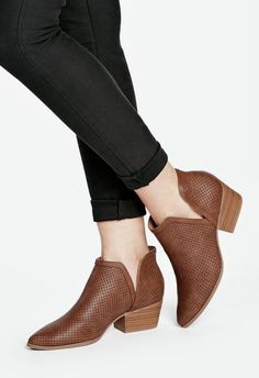 A faux split side bootie with a Cuban heel and back pull tab...