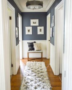 Home sweet Home Love this idea for decorating in a hallway! Navy upper walls white lower and a Love this idea for decorating in a hallway! Navy upper walls white lower and a small bench with pillows and picture frames at the end of the hallway. Home Interior, Interior Design, Interior Wall Colors, Small Bench, Farmhouse Side Table, Farmhouse Rugs, Farmhouse Style, Design Case, Style At Home
