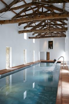 Rustic indoor pool in a home in Yorkshire, UK designed by Fiona Barratt