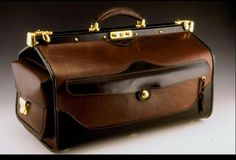 Deluxe carry on bag. This bag is built with a beautiful waxy cowhide. The sturdy construction of this piece will provide the owner with a life time of use. The gate frame closure opens the top completely for easy access.
