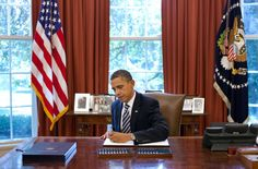 "President Obama proving, yet again, how he is a man of, by, and for the people -- signs ""Student Aid Bill of Rights."""