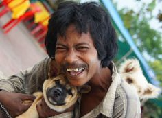 Today's daily travel photo is of a warm hearted Khmer man with his adorable dogs. His radiant smile tells the story - Battambang, Cambodia. People Around The World, Around The Worlds, Battambang Cambodia, Cambodia Travel, Man And Dog, World Of Color, Angkor, Smile Face, Travel Photos
