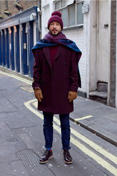 Great use of last season's dominant colors, burgundy and navy, here. He definitely looks warm, and stylish too.