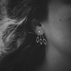 Get ready to make a statement with this design! The combo includes a pair of tiny dot studs and coordinating long stem ear jackets in your choice