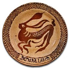 Slip ware plate by Bernard Leach . Earthenware with slip trailed and sgraffito design . around 1950