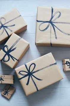 I love crafty things, but I'm not a very creative gift wrapper. I always go for simple. And what can get simpler than presents wrapped with brown paper and painted on black string?! I paint the crissc