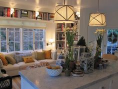 great way to incorporate lounging area and making kitchen warmer-love the bookcases! | Mark D. Sikes
