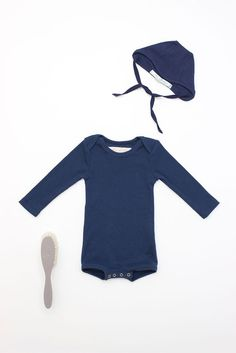 Newflora and henri classic onesie now with snap closure at bottom! 100% ribbed cotton, lap shoulder design for easy dressing....