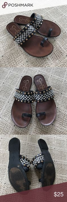 Jessica Simpson Studded Sandals Beautiful Sandals with brown leather bottom, and black/white band with gold studs. Small black strap for big toe. Barely worn and in excellent condition. Originally purchased for $55. Make a reasonable offer. No trades. 😊 Jessica Simpson Shoes Sandals