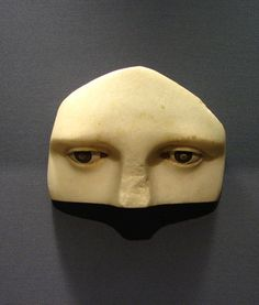 Upper part of a marble face. From the Asklepieion in Athens. Around 350B.C.