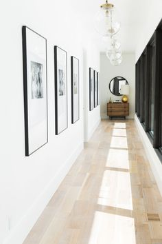 Wall of windows and simply-framed family pictures || Studio McGee