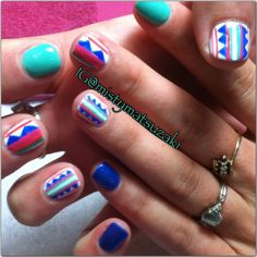 Summer fun colorful shellac and gelish design. Triangles and stripes. Nail art by misty