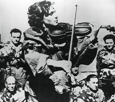 Russian army nurse playing a violin, Eastern Front, 1944. Artist: Unknown