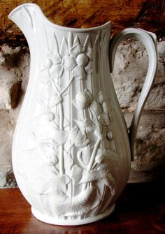 RELIEF MOULDED WHITE STONEWARE JUG c1850