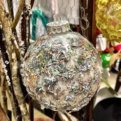 Silvered flowers on glass ornament