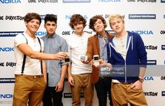 Louis Tomlinson, Zayn Malik, Liam Payne, Harry Styles and Niall Horan of One Direction launch their new Nokia handsets at the Carphone Warehouse in Oxford Street, London.