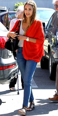 """JESSICA ALBA Your new favorite transitional weekend uniform, brought to you by the reigning jean queen: high-waisted skinnies (your girlfriends will appreciate these even if the boys don't), a comfy striped tank, a red sweater (hers is Autumn Cashmere) and comfy flats. The stripes still feel summery, but the shades say, """"Bring on fall."""""""