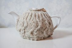 Oatmeal coloured hand knitted tea cosy with cable by SweetMaya, £16.50