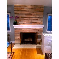 Creative fireplace idea done with timberchic reclaimed peel-and-stick wood. Find us at https://timberchic.com