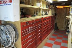 This trailer was outfitted with a combination of rolling toolboxes mounted without the wheels and custom-built shelves and cubby holes. The garden hose reel houses an electrical cord to plug into a job site for trailer power. Trailer Shelving, Van Shelving, Trailer Storage, Van Storage, Shop Storage, Garage Storage, Locker Storage, Work Trailer, Trailer Plans