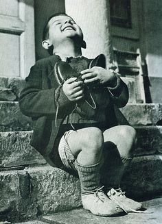 This makes me smile so much. It is an Austrian boy getting new shoes during WWII. Look how happy he was. We take everything for granted now.