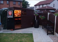 Throw open the door, add bar stools and a few bottles. The backyard pub is open for business. Read more: 'She Sheds' Are the New Man Caves Man Cave Shed, Man Cave Garage, Man Cave Garden Shed, Man Shed, Backyard Bar, Backyard Sheds, Garden Sheds, Backyard Storage, Backyard Retreat