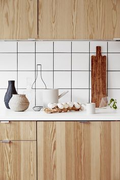 Love the wood grain finish combined with the white tiles - not to mention the styling!