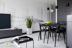 design minimalist apartment Masculine Black and White Apartment Spiced Up with Colorful Details