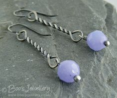Sterling silver and lavender earrings with an antiqued silver twist drop with jade faceted beads.