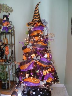 The pointy top your Christmas tree is just begging for a Halloween crooked witch's hat. As a holiday decor junkie, you clearly need a Halloween tree, a Fourth of July tree, and a Valentine's Day tree. Halloween Tree Decorations, Halloween Christmas Tree, Theme Halloween, Colorful Christmas Tree, Holiday Tree, Halloween House, Holidays Halloween, Spooky Halloween, Halloween Crafts