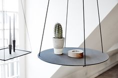 "everything-creative: ""Pendulum by LIND DNA The Pendulum is a ceiling mounted side table, that is produced as a square and a circle. In th square version you can take the tray out of the frame to use. Circle Shelf, Recycled Leather, Shop Interior Design, Danish Design, Minimalist Design, Scandinavian Design, Floating Shelves, Furniture Design, Candle Holders"