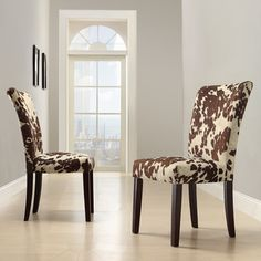 @Overstock - Add contemporary sophistication to your dining area with a pair of elegant parson dining chairs. These side chairs are wrapped with supple cow hide-print fabric thats soft to touch and boast poplar wood legs in a cherry finish for extra stability.http://www.overstock.com/Home-Garden/Portman-Cow-Hide-Parson-Side-Chairs-Set-of-2/7295836/product.html?CID=214117 $189.19