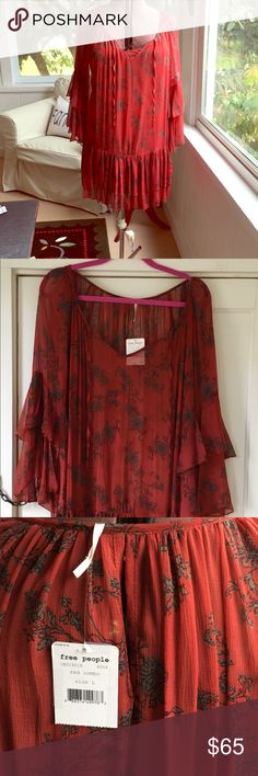 NEW Free People Size L Dress Burnt Red chiffon dress size L. Front tie and keyhole back. Layered ruffle at sleeve and at hem.  NOTE: this has never been worn BUT I noticed a small separation in front at tie seam. (Photo included) Includes under skip Free People Dresses Mini