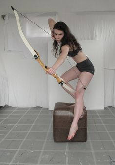 person crouching down bow and arrow - Google Search