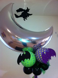 Halloween Balloon Centerpiece using Qualatex balloons.  The center is filled with dark chocolate Hershey Kisses.
