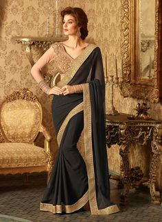 An superb Jet Black Georgette Saree will make you look too stylish and graceful. The ethnic Resham & Lace work at the clothing adds a sign of attractiveness statement with your look.
