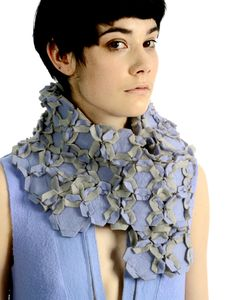 A modular design for a scarf based on a tessellation of interlocking hexagonal pieces which can be combined or taken apart at the will of th...