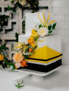 yellow black and white square minimalistic and modern wedding cake
