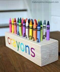 Drill holes into a wooden block for a crayon holder, this might be better for a toddler than trying to deal with the box and it's more fun to look at