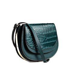 Teal. Shoulder bag in imitation leather with a narrow, adjustable shoulder strap, patterned flap with magnetic fastener, decorative metal frame, and outer