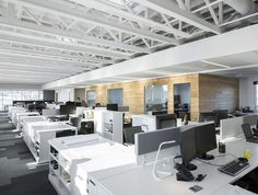 STGM Architects, headquarters, Quebec, Canada, office space, natural lighting, water management, energy-efficient building, wooden facade, timber facade, solar wall, green architecture, prefab building, open-plan office, LED lights