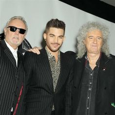 Adam Lambert appears with Queen members Brian May and Roger Taylor at a press conference at New York City's Madison Square Garden on March 6, 2014, in which they announced a summer North American tour.