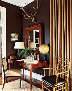 We painted the listening room side of our basement a color very similar to this one.  Not quite brown, not quite purple, dark and warm.  We love it.  Ours is Wenge by Benjamin Moore